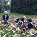 Playing with cousins in the leaves